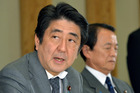 Prime Minister Shinzo Abe's economic revival strategy for Japan centers on cheap credit. Photo / AP
