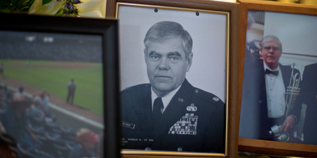 Photo of Ret. Lt. Col. Ronald Westbrook sits on the coffee table in his home. Photo / AP