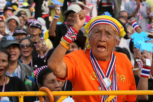 An elderly Thai woman shouts anti-government slogans during a rally at the Democracy Monument in Bangkok. Photo / AP
