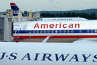 American Airlines is now out of bankruptcy protection and US Airways has got a partner, as the two airlines now have formalised their merger. Photo / AP