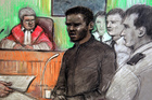 Court artist sketch by Elizabeth Cook of Michael Adebolajo, centre, who is one of the men accused of killing British soldier Lee Rigby in May, as he gave evidence. Photo / AP