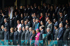 VIP's and dignitaries stand up for the start of the memorial service for former South African president Nelson Mandela. Photo / AP