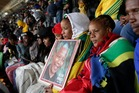 People at a memorial service for Nelson Mandela at the FNB Stadium in Soweto. Photo / AP