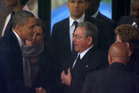 US President Barack Obama shakes hands with Cuban President Raul Castro at the FNB Stadium in Soweto, South Africa. Photo / AP