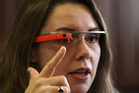 Dr. Heather Evans points to the new Google Glass device at Harborview Medical Center, in Seattle, Washington. Photo /AP