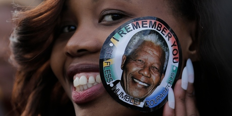 A woman visits Mandela's casket. Photo / AP