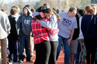 Students comfort each other at Arapahoe High School in Colorado. Photo / AP Ed Andrieski
