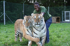 Big cat handler Dalu Mncube with his beloved Kahli and Indira.