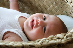 A baby in a wahakura, a safe sleeping space, to help prevent Sudden Unexpected Death in Infancy (SUDI). Photo / Whakawhetu