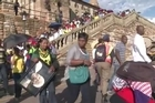 Hundreds of South Africans broke through a police cordon Friday in a last-gasp bid to join the estimated 100,000 people who viewed Nelson Mandela's remains during three days of lying in state.
