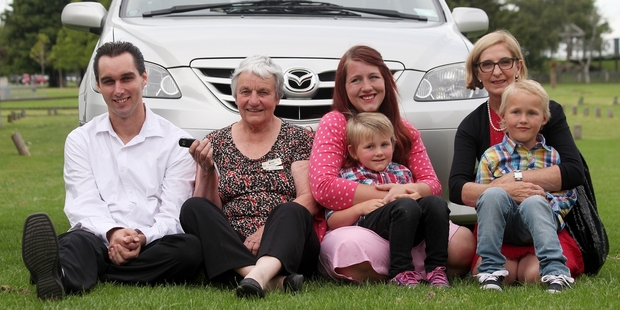 James Fowler-Oates, left, Ann Pritchard, Nikki Stokes with Rhys, 4, and Sally Morrison with Hunter, 6, and the new car.Photo/Andrew Warner.