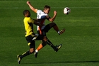 Phoenix attacker Paul Ifill puts Roar defender Matt Smith under pressure. Photo / Getty Images