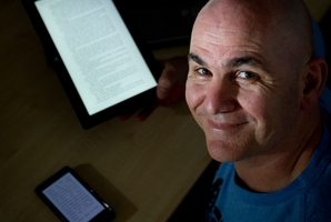 Ian Lawsen got his first eReader sent over from the US in 2007. Photo / Sarah Ivey