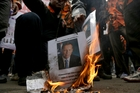 Diplomatic relations between Australia and Indonesia are tense following a spy scandal which has led to protesters burning posters of Prime Minister Tony Abbott.  Photo / AP