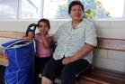Smoker Rose Moses with Charlotte-Rose Moses, 4, at Rose St bus terminal yesterday. She supports a smoking ban at bus stops. Photo / John Stone