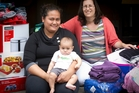 Co-ordinator Christina Teikamata (right) helps a resident and her baby. Photo / Sarah Ivey