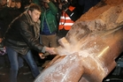 Pro-European Ukrainians smash a statue of Lenin in protest at the Government's pursuit of closer ties to Russia at the expense of the West. Photo / AP