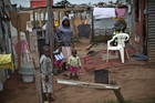 Living conditions in many poor, crowded townships are a far cry from the sumptuous homes in grand suburbs. Photo / AP