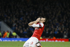 Arsenal's Olivier Giroud puts his hands to his head as he reacts in frustration to missing a chance to score a goal. Photo / AP