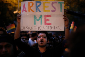 An Indian gay rights activist holds up a placard during a protest. Photo / AP