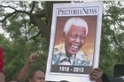 Nelson Mandela's flag-draped casket made a solemn journey through the streets of Pretoria Wednesday, where it will lie in state for three days. Along the route South Africans formed a sombre guard of honour for their iconic leader.