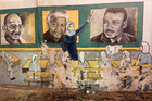 Mural on the wall of one of the universities in Gaza City featuring Nelson Mandela - learning about international heroes for social justice. Photo/Roger Fowler.