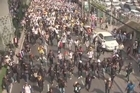 """Thailand's premier called a snap election Monday to try to defuse the kingdom's political crisis, but protesters vowed to keep up their """"people's revolution"""" as an estimated 140,000 demonstrators flooded the streets of Bangkok."""