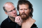 Facial reconstruction expert Oscar Nilsson adds finishing touches to the early Briton.