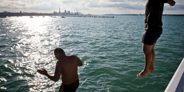 Josh Tomai, 14, and Tarahawaiiki Hawk, 15, cool off  from Okahu Wharf near Mission Bay.  Photo / Greg Bowker