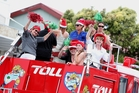 There was a truckload of season's cheer from these Toll and MediaWorks staff who tootled around town yesterday afternoon in the Toll vintage fire truck.
