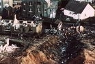 Wrecked houses and a deep gash in the ground in Lockerbie. Photo / AP