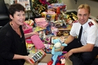 COMMUNITY SPIRIT: Times-Age advertising manager Bex Johnson hands over the haul of presents for the needy to Masterton Salvation Army Lieutenant Daryn Bishop. PHOTO/LYNDA FERINGA