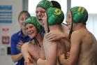 Tauranga players celebrate after winning a bronze medal at Bayfair. Photo/John Borren