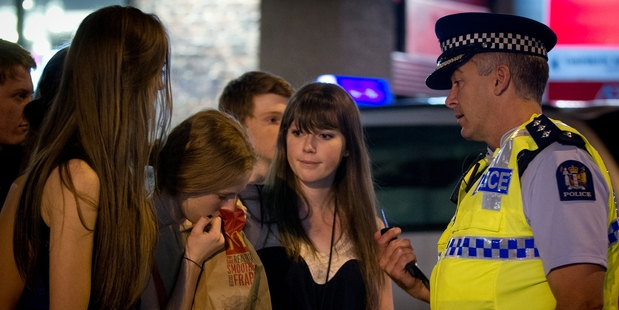 Inspector Gary Davey says much of his job is to make sure people like this young woman and her friends get home safely from their night out in central Auckland. Photo / Sarah Ivey