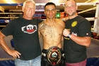 Gunnar Jackson with supporters Russell Thomson (left) and Craig Thomson after his title-winning bout.Photo/Supplied