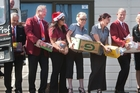 Professionals McDowell Real Estate director Ian McDowell (far left) and staff deliver the food they donated to the <i>Rotorua Daily Post Christmas Appeal</i>. Photo / Ben Fraser