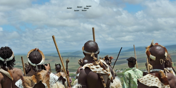 A group of Zulu warriors watch a fly-past during the burial of former South African president Nelson Mandela in Qunu. Photo/ AP