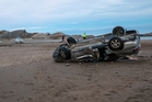 SMASH: A car which rolled on Castlepoint Beach this month. PHOTO/FILE