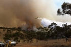 South Australia Country Fire Service volunteers tackle a bushfire near Rockleigh in South Australia.