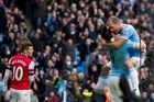 Alvaro Negredo and Pablo Zabaleta, right, celebrate a City goal. Photo / AP