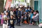 Every day families queue at the Auckland City Mission for food and presents for the children. Photo / Greg Bowker