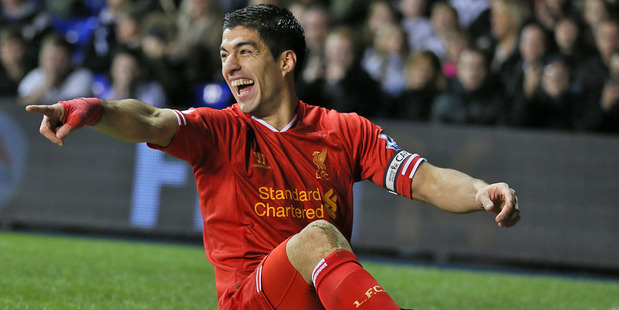 Liverpool's Luis Suarez celebrates after scoring against Tottenham. Photo / AP