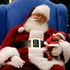 Dressed as Santa Claus, Mark Tate pretends to sleep as he poses for photos with 4-week-old Leilani Mejico at a mall in Cerritos, California. Photo / AP