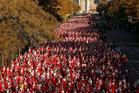 Revellers dressed as Santa Claus run during a Marathon in Madrid, Spain. Photo / AP