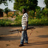 A former FARCA (Central African Republic Forces) soldier linked to Anti-Balaka Christian militiamen walks with rocket propelled grenades outside a school where they set up camp. Photo / AP