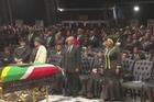 Guests gathered on Sunday in a huge tent at the family compound of Nelson Mandela to attend the funeral ceremony for the anti-apartheid leader.