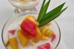 Coconut cream and tropical fruit. Photo / Grant Allen