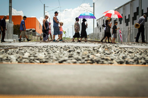 Those taking part in the blessing walk across the Walters Road crossing. Photo / Michael Craig