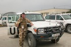 Andy Grant was saved by the British when he had a close call with a group of roaming wild dogs in Kabul.