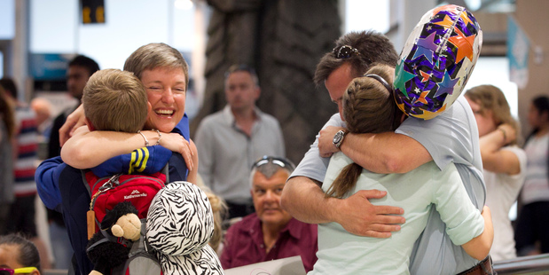 The Viljoens welcome back children Degan (left), 14, and Demi, 15, from Spain where they've been on an exchange programme. Photo / Natalie Slade